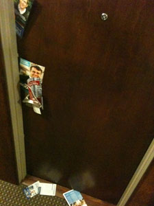 Ward 27 campaign flyers in a door